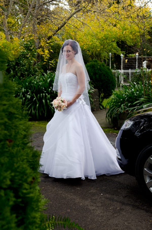 A bridal portrait showing the front garden of Bram Leigh receptions