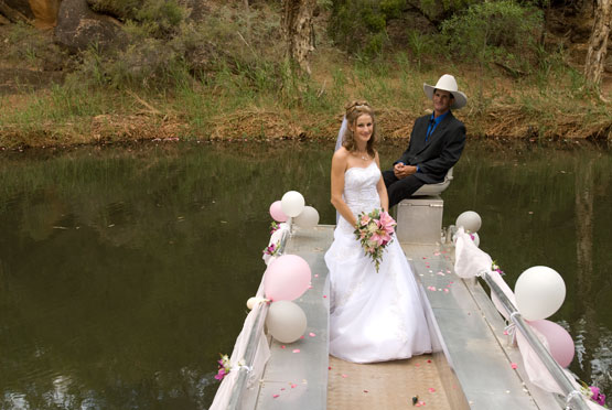 wedding photography with bridal couple on a flat bottomed boat.